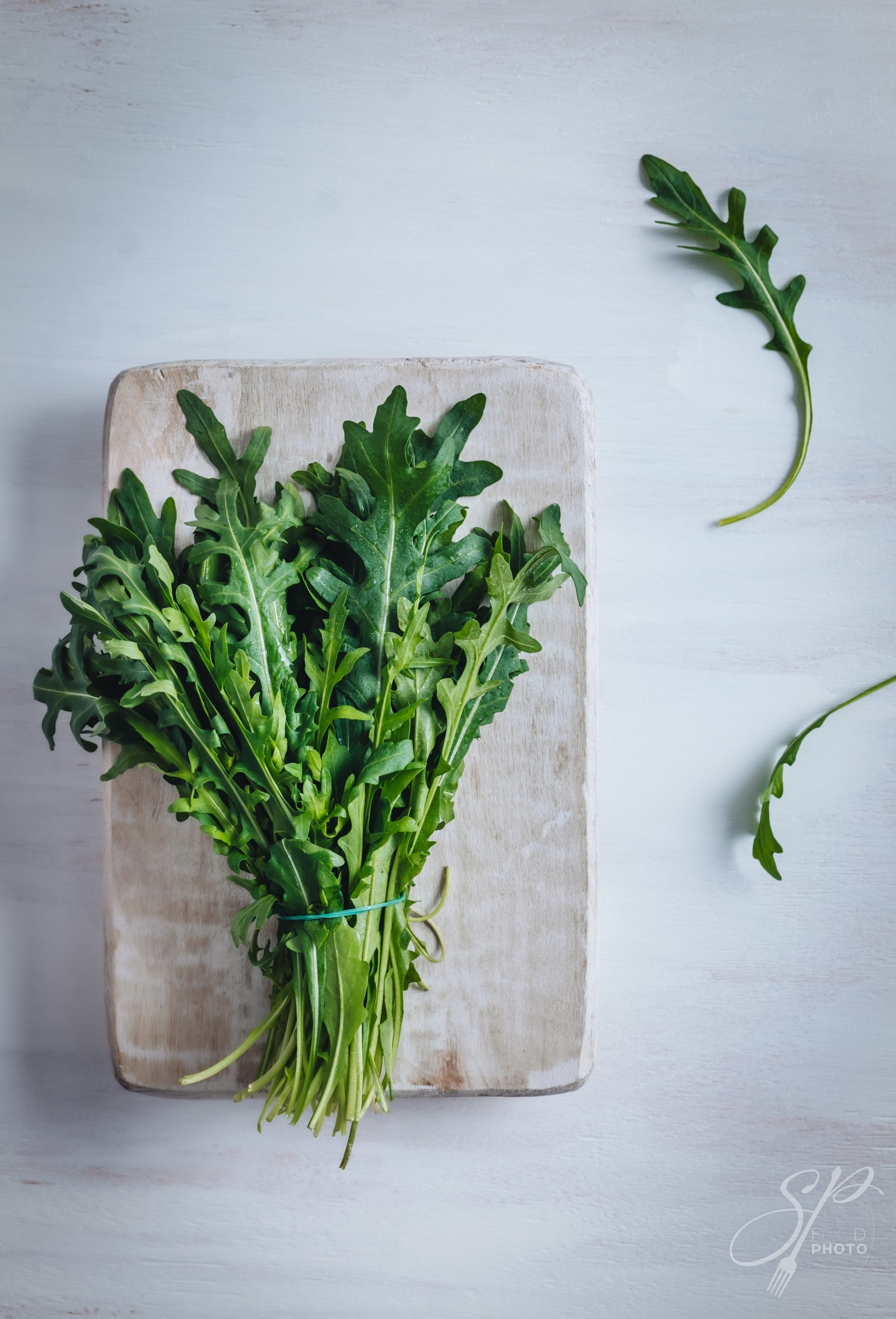 Fresh rocket leaves on a wooden table