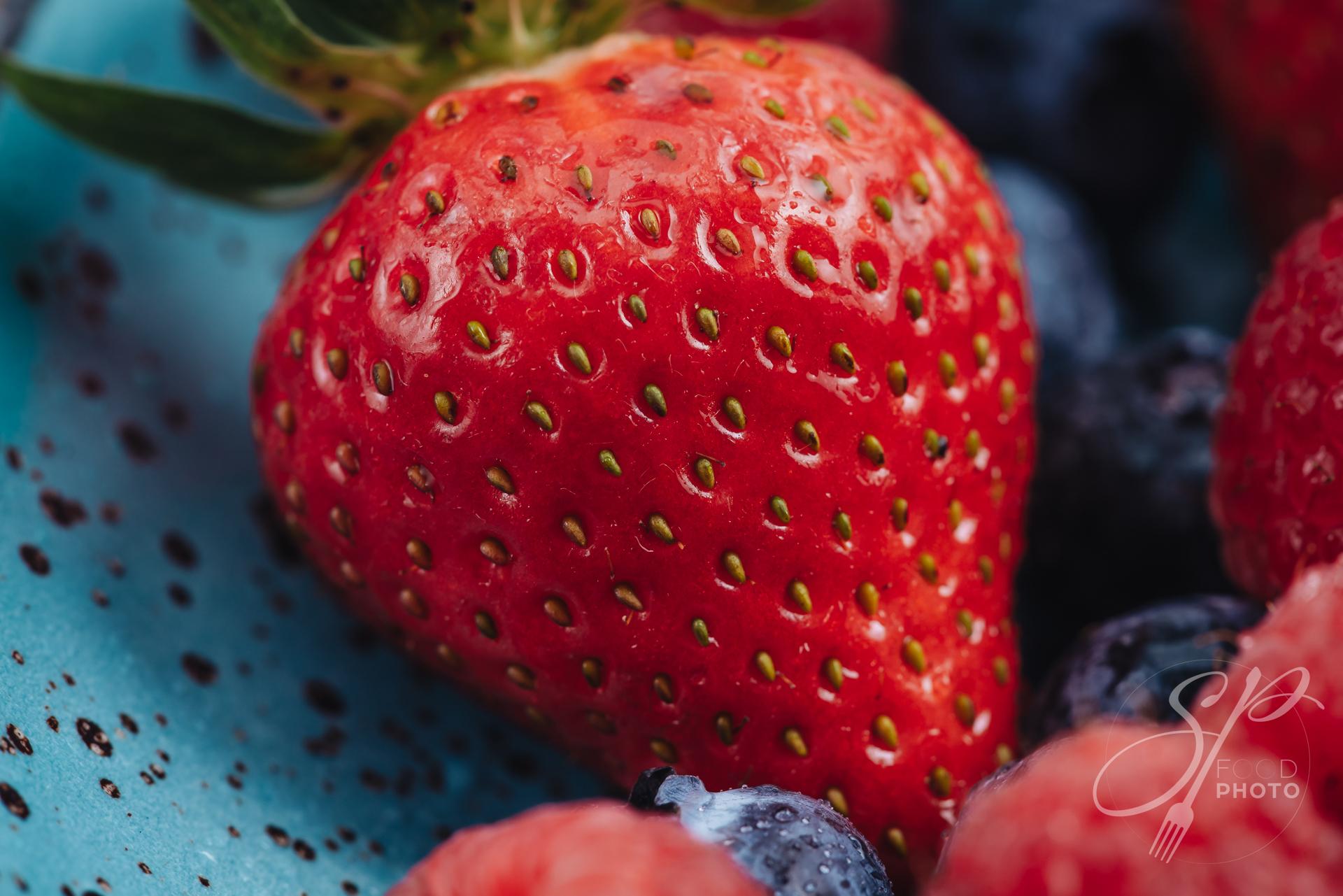 Beautiful macro of a fresh strawberry at breakfast